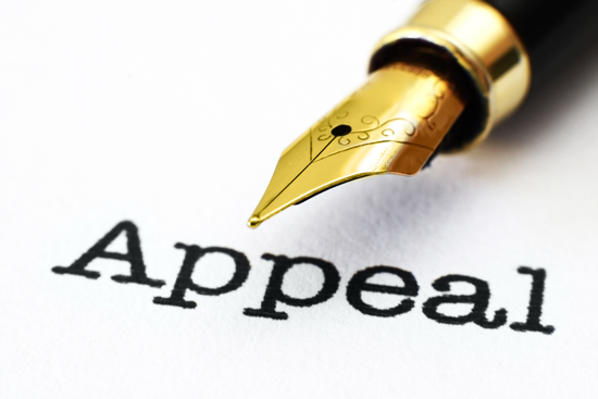 appeal typed on white paper with calligraphy pen hovering