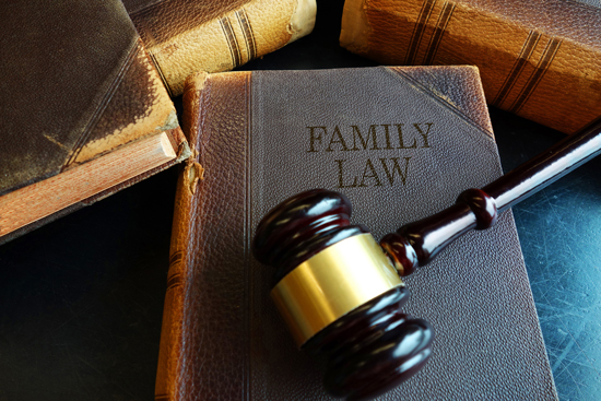family law title on old book with gavel on top